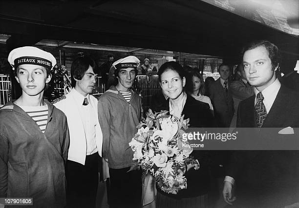 King Carl Gustaf XVI and Queen Silvia of Sweden meet the crew of a 'bateaumouche' before a sightseeing trip down the Seine Paris 10th November 1976