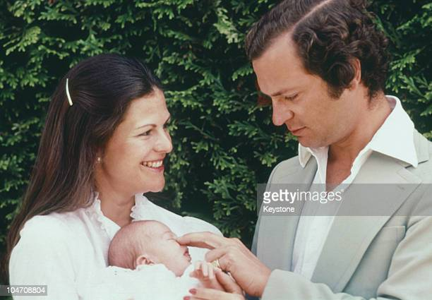 King Carl Gustaf XVI and Queen Silvia of Sweden with their baby daughter Princess Victoria at Solliden Castle on August 02 1977