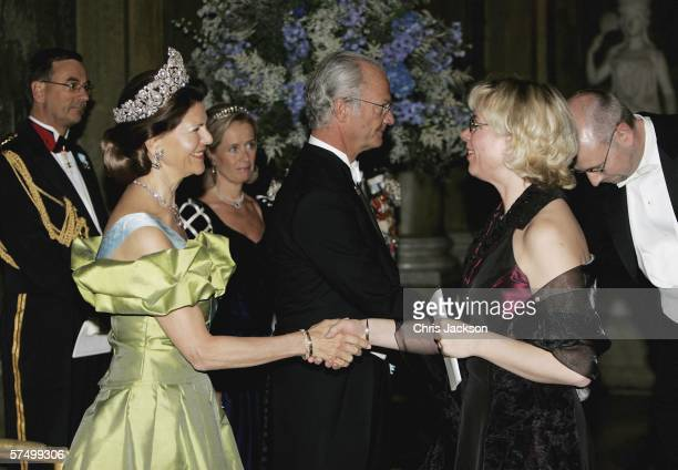 M King Carl Gutaf XVI and Queen Silvia greet guests as they arrive for the Gala Dinner at Royal Palace to celebrate King Carl XVI Gustaf of Sweden's...
