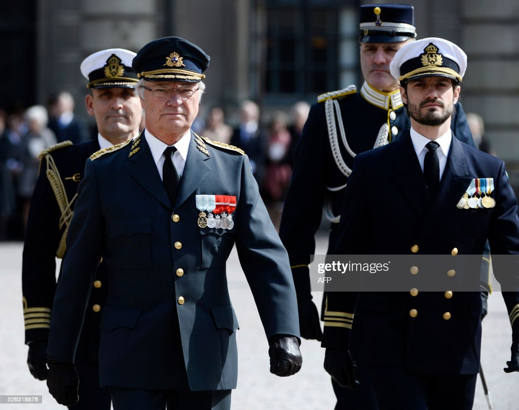 King Carl XVI Gustaf (L) and Prince Carl Philip arrive on the outer courtyard at the Royal Palace in Stockholm, Sweden, for the Kings 70th birthday celebrations,on April 30, 2016. News Agency / Maja Suslin/TT / Sweden OUT