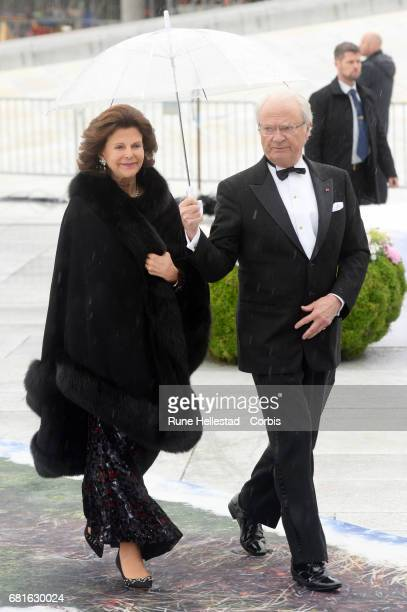 King Carl XVI Gustaf and Queen Silvia of Sweden are seen arriving at the Opera House on the occasion of the celebration of King Harald and Queen...