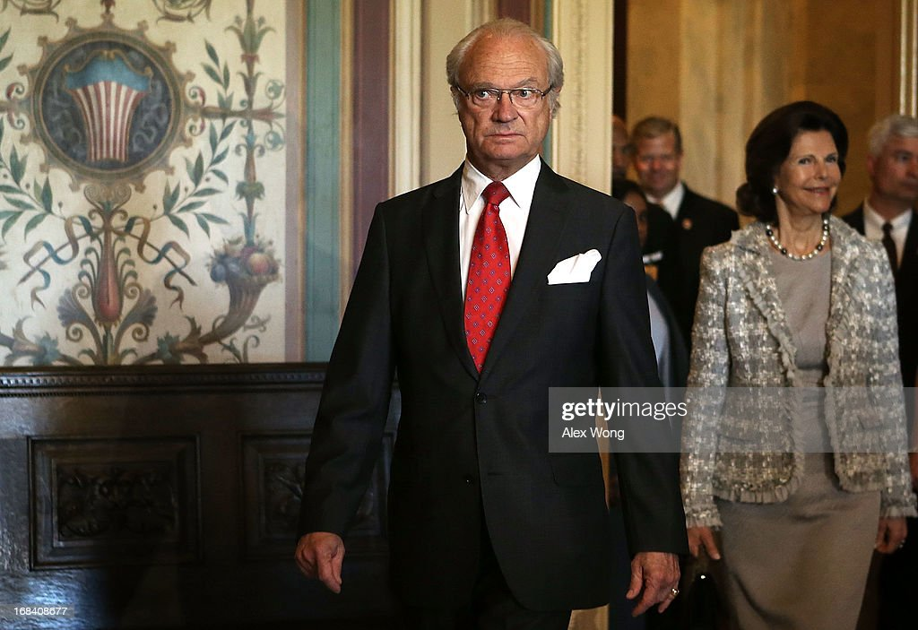 King Carl XVI Gustaf (L) and Queen Silvia (R) of Sweden arrive at a lunch meeting on Capitol Hill May 9, 2013 in Washington, DC. King Carl XVI Gustaf and Queen met with members of the Swedish Congressional Caucus during the meeting.