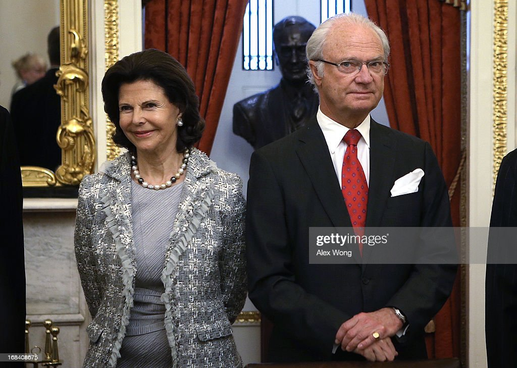 King Carl XVI Gustaf (R) and Queen Silvia (L) of Sweden attend a lunch meeting on Capitol Hill May 9, 2013 in Washington, DC. King Carl XVI Gustaf and Queen met with members of the Swedish Congressional Caucus during the meeting.