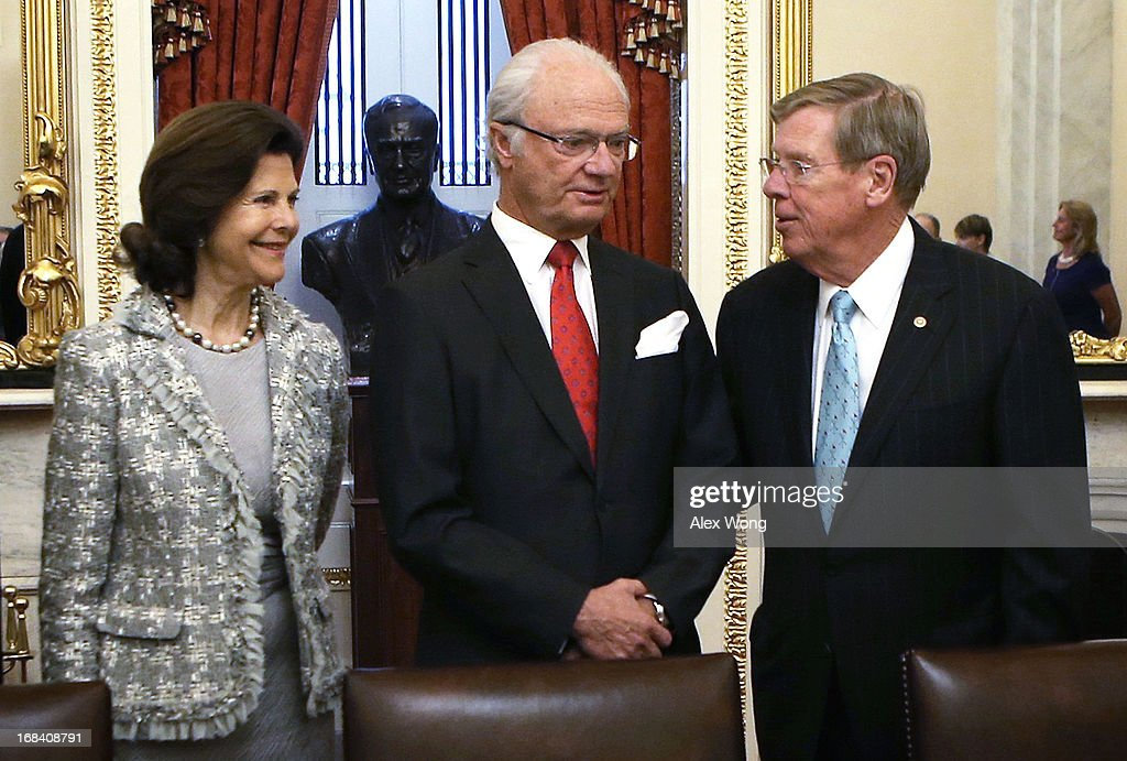 King Carl XVI Gustaf (2nd L) and Queen Silvia (L) of Sweden attend a lunch meeting with U.S. Sen. <a gi-track='captionPersonalityLinkClicked' href=/galleries/search?phrase=Johnny+Isakson&family=editorial&specificpeople=534354 ng-click='$event.stopPropagation()'>Johnny Isakson</a> (R-GA) (R) on Capitol Hill May 9, 2013 in Washington, DC. King Carl XVI Gustaf and Queen met with members of the Swedish Congressional Caucus during the meeting.