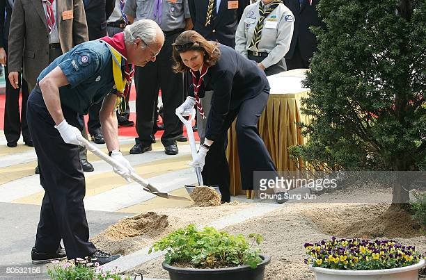King Carl XVI Gustaf and Queen Silvia of Sweden plant a commemorative tree with Boy Scouts at the Soongeui elementary school on April 5 2008 in Seoul...
