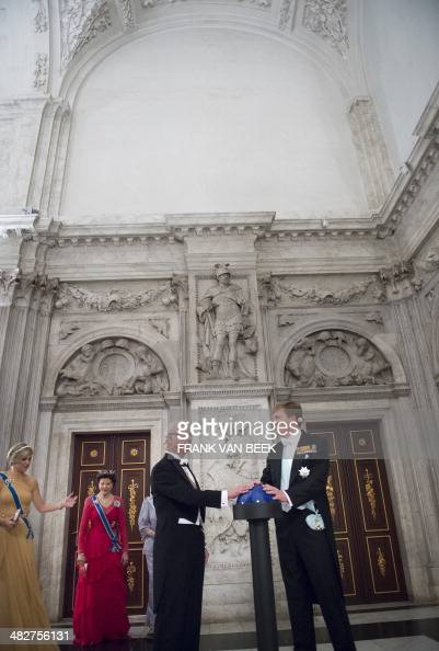 King Carl XVI Gustaf of Sweden and Dutch King WillemAlexander prepare to launch a projection of a Rembrandt painting on a wall of the Royal Palace in...
