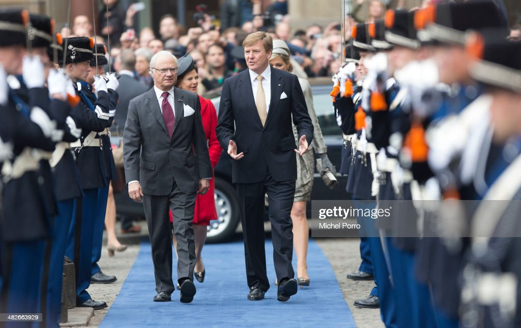 King Carl XVI Gustaf Of Sweden and <a gi-track='captionPersonalityLinkClicked' href=/galleries/search?phrase=King+Willem-Alexander&family=editorial&specificpeople=160214 ng-click='$event.stopPropagation()'>King Willem-Alexander</a> of The Netherlands walk towards the Royal Palace at the start of an official two day Visit Holland on April 4, 2014 in Amsterdam, Netherlands.