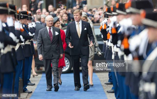 King Carl XVI Gustaf Of Sweden and King WillemAlexander of The Netherlands walk towards the Royal Palace at the start of an official two day Visit...