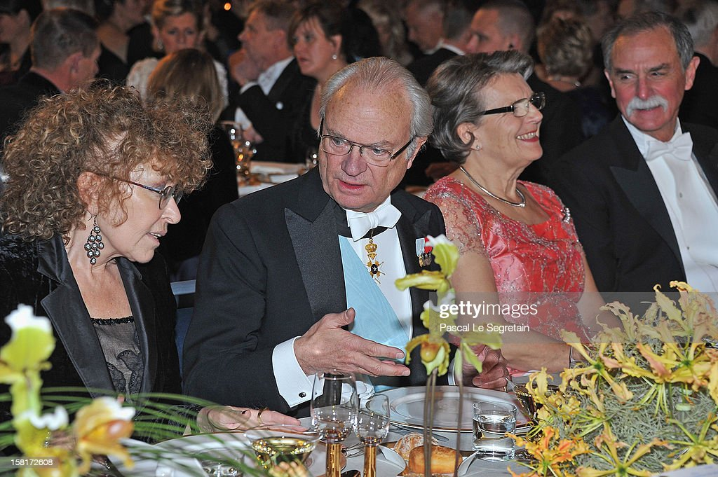 King Carl XVI Gustaf of Sweden (2nd L) and Nobel Prize in Physics laureate Dr David J. Wineland of the USA (R) attend the Nobel Banquet at Town Hall on December 10, 2012 in Stockholm, Sweden.
