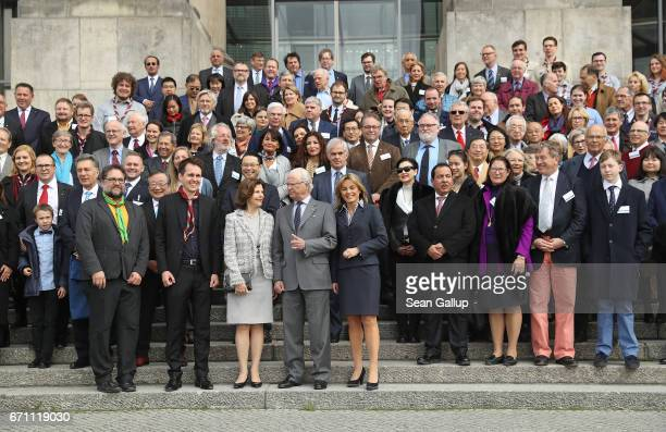King Carl XVI Gustaf of Sweden and Queen Silvia of Sweden and Bundestag vicepresident Michaela Noll pose with members of the World Scout Foundation...