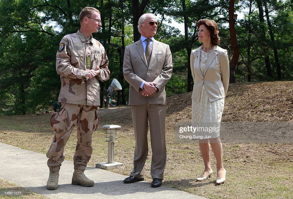 King Carl XVI Gustaf of Sweden and Queen Silvia of Sweden visit at Swedish Camp of the Neutral Nations Supervisory Camp (NNSC) at the border village of panmunjom between South and North Korea in the demilitarized zone (DMZ) on June 1, 2012, South Korea. The Swedish royals are on the four-day tour to South Korea.