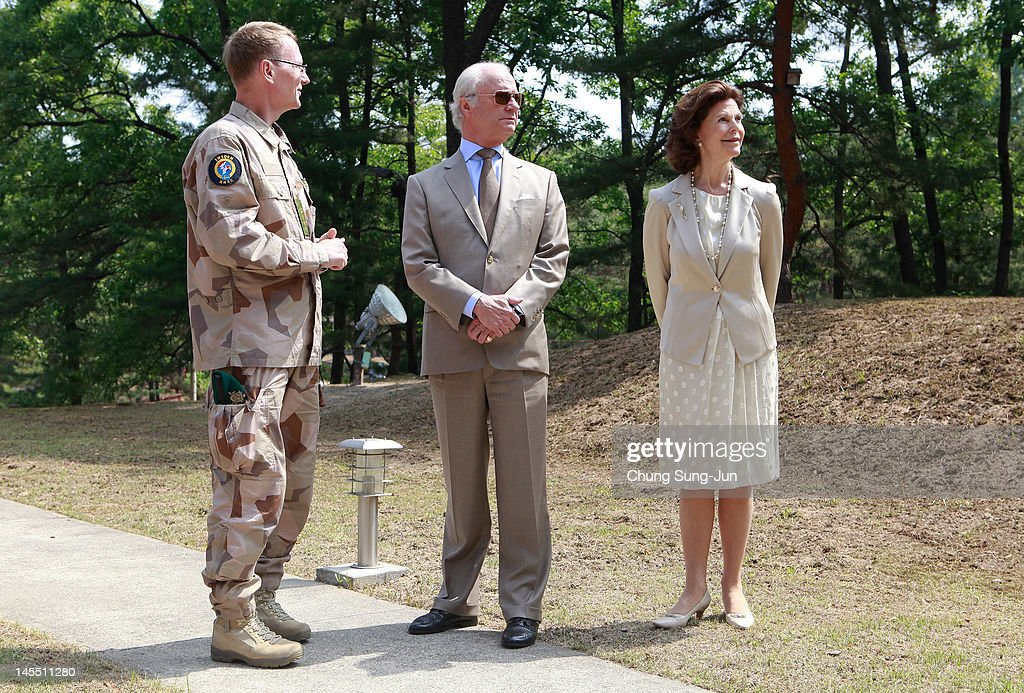 King Carl XVI Gustaf of Sweden and <a gi-track='captionPersonalityLinkClicked' href=/galleries/search?phrase=Queen+Silvia+of+Sweden&family=editorial&specificpeople=160332 ng-click='$event.stopPropagation()'>Queen Silvia of Sweden</a> visit at Swedish Camp of the Neutral Nations Supervisory Camp (NNSC) at the border village of panmunjom between South and North Korea in the demilitarized zone (DMZ) on June 1, 2012, South Korea. The Swedish royals are on the four-day tour to South Korea.