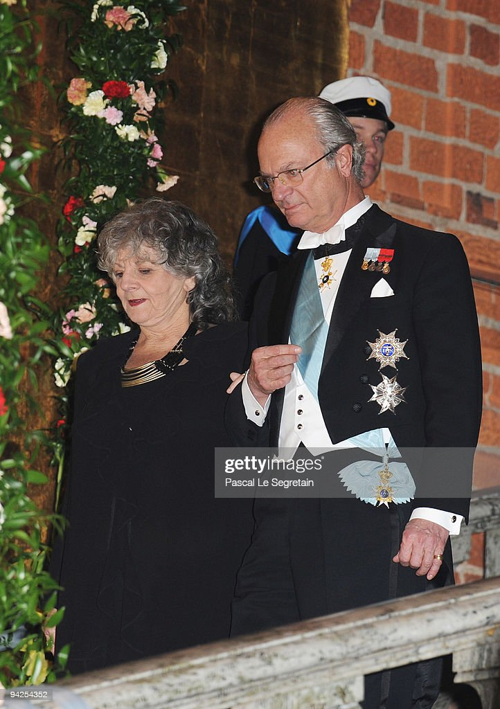 King Carl XVI Gustaf of Sweden arrives with Ada E. Yonath of Israel, winner of the Nobel Prize in Chemistry during the Nobel Foundation Prize Banquet 2009 at the Town Hall on December 10, 2009 in Stockholm, Sweden.