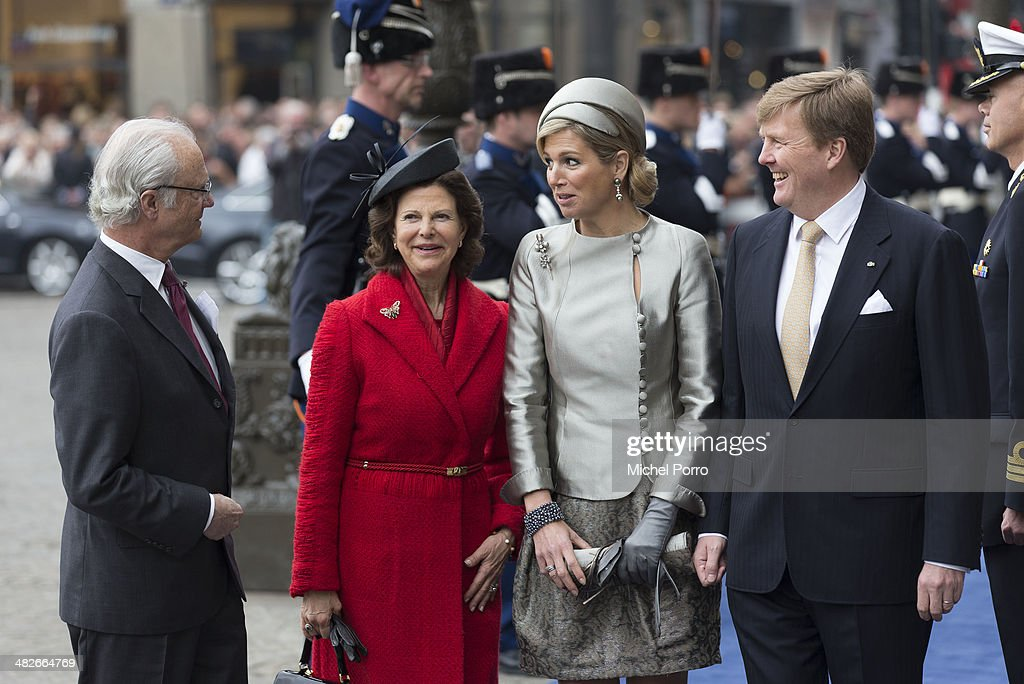 King Carl XVI Gustaf Of Sweden, <a gi-track='captionPersonalityLinkClicked' href=/galleries/search?phrase=Queen+Silvia+of+Sweden&family=editorial&specificpeople=160332 ng-click='$event.stopPropagation()'>Queen Silvia of Sweden</a>, Queen Maxima of The Netherlands and <a gi-track='captionPersonalityLinkClicked' href=/galleries/search?phrase=King+Willem-Alexander&family=editorial&specificpeople=160214 ng-click='$event.stopPropagation()'>King Willem-Alexander</a> of The Netherlands arrive at the Royal Palace at the start of an official two day Visit Holland on April 4, 2014 in Amsterdam, Netherlands. on April 4, 2014 in Amsterdam, Netherlands.