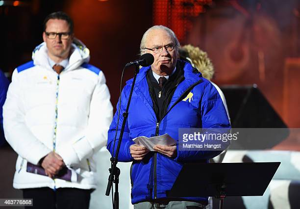 King Carl XVI Gustaf of Sweden talks during the Opening Ceremony of the FIS Nordic World Ski Championships at the Lugnet venue on February 18 2015 in...
