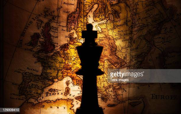King chess piece on old world map