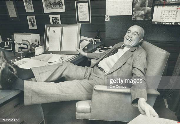 King Clancy relishes premier's tribute Maple Leaf's vicepresident King Clancy relaxes in his Gardens office with special plaque presented by Ontario...