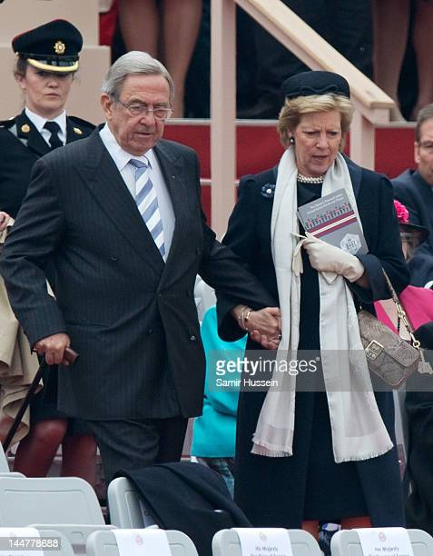 King Constantine II of Greece and Queen AnneMarie Of Greece attend the Armed Forces Parade And Muster at Home Park on May 19 2012 in Windsor England