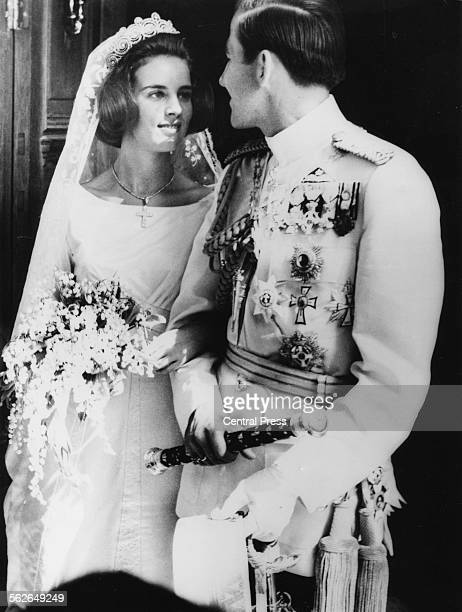 King Constantine of Greece and his bride AnneMarie on their wedding day outside Athens Orthodox Cathedral September 19th 1964