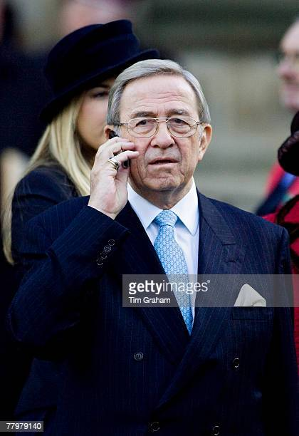 King Constantine of Greece chats on a mobile phone after attending a service of thanksgiving at Westminster Abbey to celebrate the Queen and Prince...