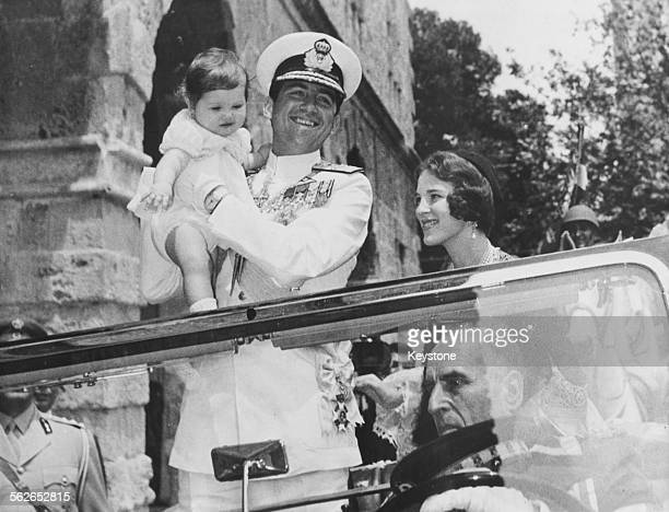 King Constantine of Greece with his wife Queen Anne Marie and baby daughter Princess Alexia in an open car driving to Te Deum at Naufplio May 24th...