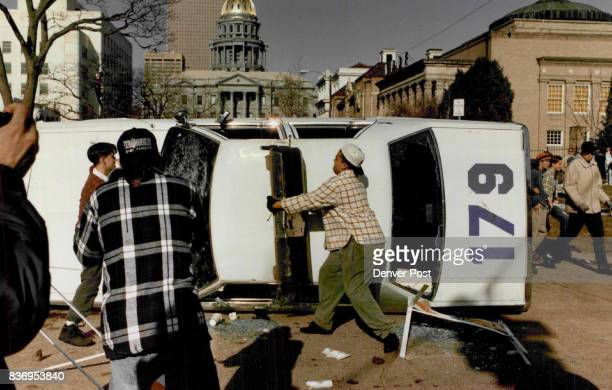 King Day ViolenceRioters destroy a Denver police cruiser just south of the state capitol building in Denver Monday when an antiKu Klux Klan...