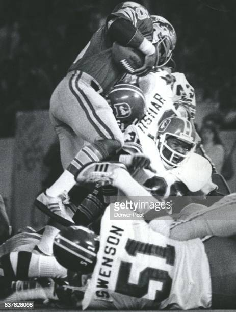 King driver over the Denver defense for the winning touch down in the early 4th quarter Bill Thompson screams as he in hurt an the play Credit Denver...
