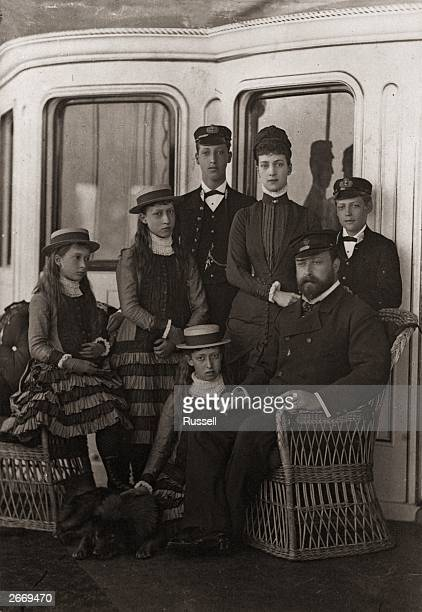 King Edward VII and his family on board the royal yacht 'Osborne' during Cowes Week on the Isle of Wight With him are his wife Queen Alexandra his...