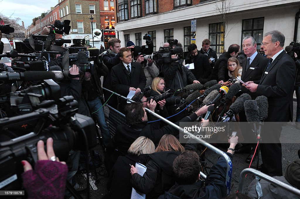King Edward VII hospital chief executive John Lofthouse (R) speaks to the media outside the hospital in London on December 7, 2012 after the body of nurse Jacintha Saldanha was found dead at a property close by. A nurse at the hospital which treated Prince William's pregnant wife Catherine, Duchess of Cambridge, was found dead on December 7, days after being duped by a hoax call from an Australian radio station, the hospital said. Police said they were treating the death, which happened at a property near the hospital, as unexplained.