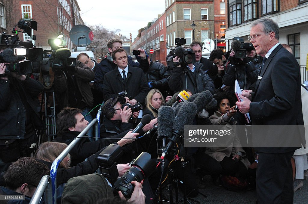 King Edward VII hospital chief executive John Lofthouse (R) speaks to the media outside the hospital in London on December 7, 2012 after nurse Jacintha Saldanha was found dead at a property close by. A nurse at the hospital which treated Prince William's pregnant wife Catherine, Duchess of Cambridge, was found dead on December 7, days after being duped by a hoax call from an Australian radio station, the hospital said. Police said they were treating the death, which happened at a property near the hospital, as unexplained.