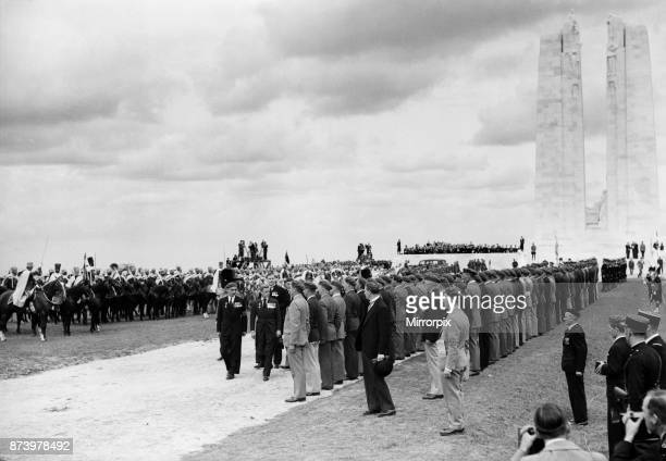 King Edward VIII in his capacity as King of Canada inspecting veterans at the opening of the Canadian War Memorial at Vimy Ridge The King was...