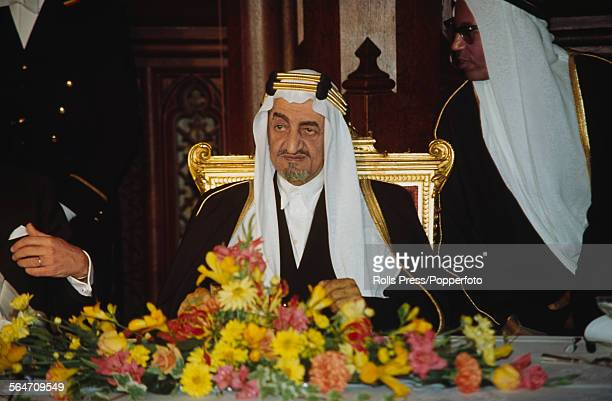 King Faisal of Saudi Arabia pictured seated at a conference in London in 1967