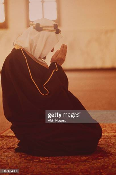 King Faisal of Saudi Arabia prays in his personal mosque located in the gardens of his Palace in Riyadh The king prays five times a day usually with...