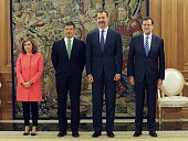 King Felipe of Spain poses with newly appointed Spanish Justice Minister Rafael Catala Deputy Prime Minister and government spokeswoman Soraya Saenz...