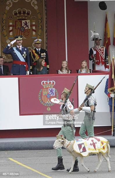 King Felipe of Spain Queen Letizia of Spain Princess Leonor and Princess Sofia attend the National Day Military Parade on October 12 2014 in Madrid...