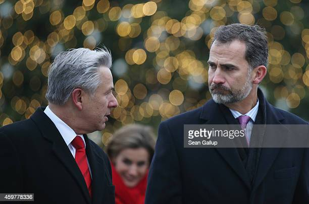 King Felipe VI and Queen Letizia of Spain are accompanied by Berlin Mayor Klaus Wowereit as they visit Brandenburg Gate and walk past a Christmas...