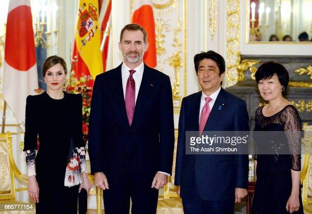 King Felipe VI and Queen Letizia of Spain pose for photographs with Japanese Prime Minister Shinzo Abe and his wife Akie during their meeting at the...