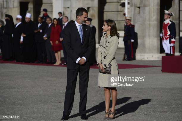King Felipe VI and Queen Letizia of Spain wait for the arrival of the Israeli president and first lady during a welcoming ceremony at the Royal...