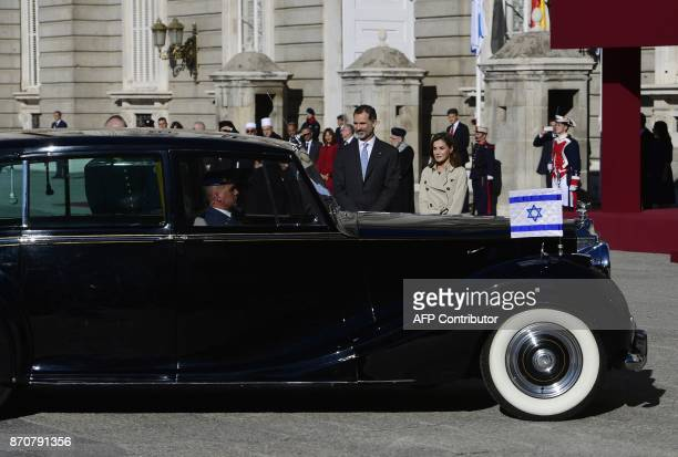 King Felipe VI and Queen Letizia of Spain wait to greet the Israeli president and first lady during a welcoming ceremony at the Royal Palace in...