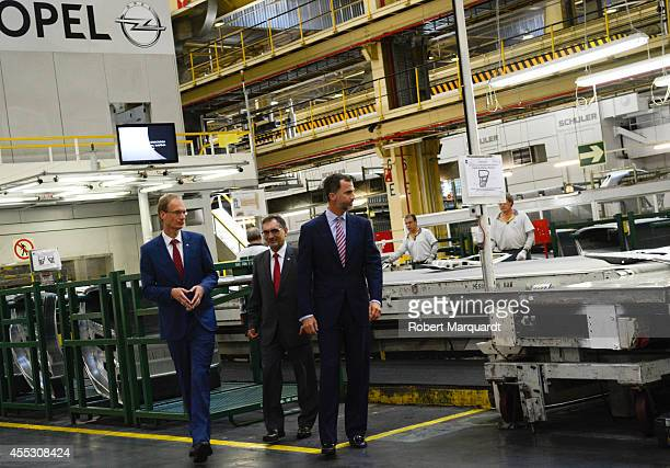 King Felipe VI of Spain and Antonio Cobo Director General of General Motors Spain visit the General Motors Opel plant on September 12 2014 in...