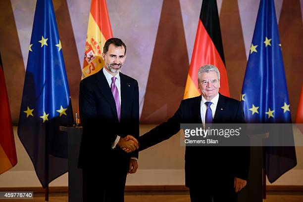 King Felipe VI of Spain and German President Joachim Gauck shake hands after a press conference at Schloss Bellevue Presidential Pallace on December...