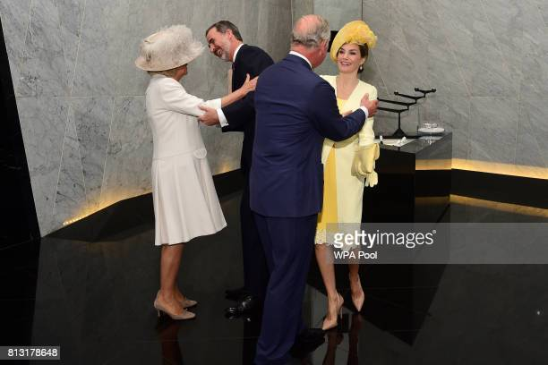 King Felipe VI of Spain and his wife Queen Letizia of Spain are greeted by Prince Charles Prince of Wales and Camilla Duchess of Cornwall at their...