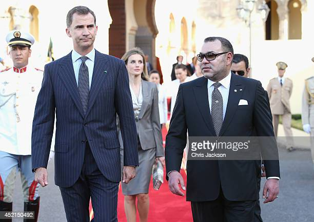 King Felipe VI of Spain and King Mohammed VI of Morocco walk along the red carpet to the Royal Palace on July 14 2014 in Rabat Morocco The new King...
