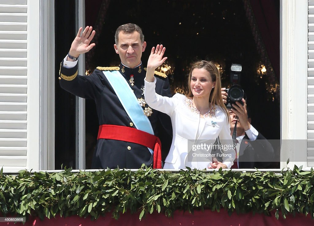 King Felipe VI of Spain and Queen Letizia of Spain appear at the balcony of the Royal Palace during the King's official coronation ceremony on June 19, 2014 in Madrid, Spain. The coronation of King Felipe VI is held in Madrid. His father, the former King Juan Carlos of Spain abdicated on June 2nd after a 39 year reign. The new King is joined by his wife Queen Letizia of Spain.