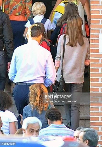 King Felipe VI of Spain and Queen Letizia of Spain arrive at 'Santa Maria de los Rosales' school in the first day of school on September 12 2014 in...