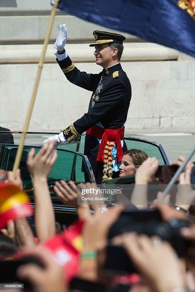 King Felipe VI of Spain and Queen Letizia of Spain arrive at the Royal Palace after the King's official coronation at the parliament on June 19, 2014 in Madrid, Spain. The coronation of King Felipe VI is held in Madrid. His father, the former King Juan Carlos of Spain abdicated on June 2nd after a 39 year reign. The new King is joined by his wife Queen Letizia of Spain.