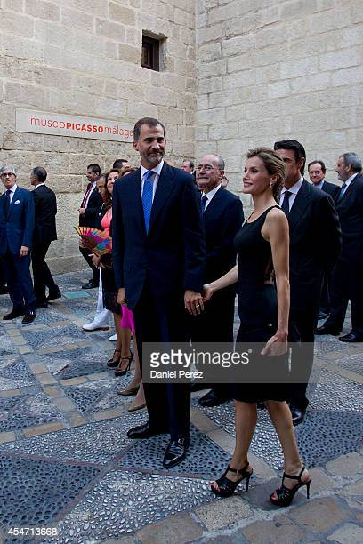 King Felipe VI of Spain and Queen Letizia of Spain arrive at the Malaga Picasso Museum on September 5 2014 in Malaga Spain