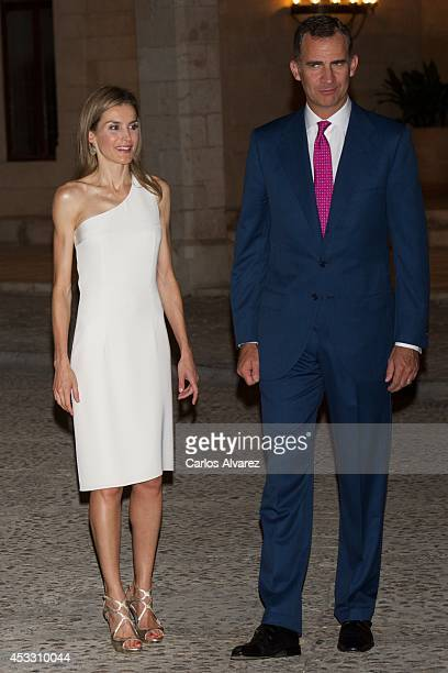 King Felipe VI of Spain and Queen Letizia of Spain attend a official reception at the Almudaina Palace on August 7 2014 in Palma de Mallorca Spain