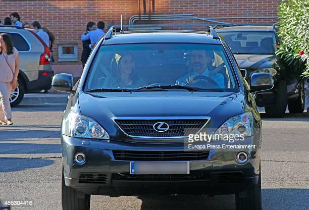 King Felipe VI of Spain and Queen Letizia of Spain leave 'Santa Maria de los Rosales' school in the first day of school on September 12 2014 in...