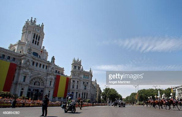 King Felipe VI of Spain and Queen Letizia of Spain make the journey to Royal Palace after the King's official coronation ceremony at Cibeles square...